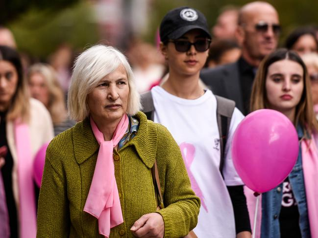 Women wear pink scarves during a march for International Breast Cancer Awareness Month, to raise awareness on breast cancer and to promote prevention. Picture: AFP