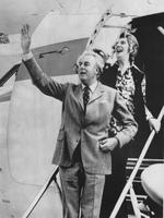 The PRIME Minister-elect, Mr Gough Whitlam, and his wife, Margaret, acknowledge a tumultuous welcome as they step from their VIP jet in Canberra yesterday. Pic Ray Strange