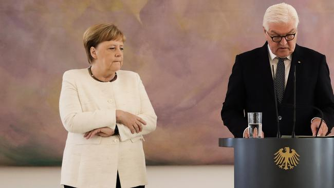 During the ceremony, Merkel suffered a shaking spell. Picture: Kay Nietfeld / dpa / AFP