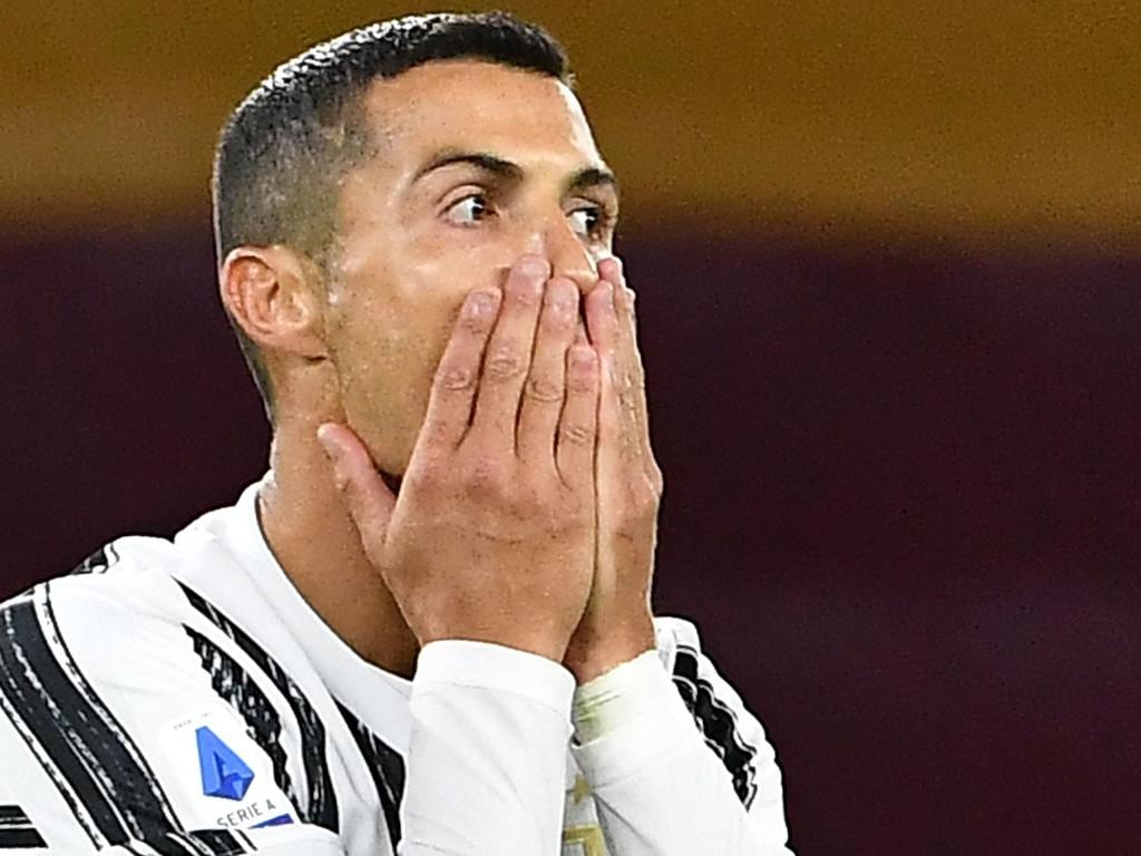 (FILES) In this file photo taken on September 27, 2020 Juventus' Portuguese forward Cristiano Ronaldo reacts after missing a goal opportunity during the Italian Serie A football match Roma vs Juventus on September 27, 2020 at the Olympic stadium in Rome. - Cristiano Ronaldo has tested positive for Covid-19, the Portuguese Football Federation announced on October 13, 2020. (Photo by Tiziana FABI / AFP)