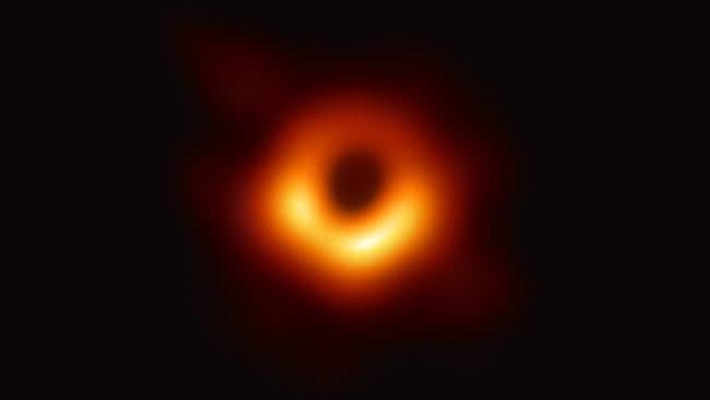 "A handout photo provided by the European Southern Observatory on April 10, 2019 shows the first photograph of a black hole and its fiery halo, released by Event Horizon Telescope astronomers (EHT), which is the ""most direct proof of their existence,"" one of the project's lead scientists told AFP. (Photo by - / EUROPEAN SOUTHERN OBSERVATORY / AFP) / RESTRICTED TO EDITORIAL USE - MANDATORY CREDIT ""AFP PHOTO / EUROPEAN SOUTHERN OBSERVATORY"" - NO MARKETING NO ADVERTISING CAMPAIGNS - DISTRIBUTED AS A SERVICE TO CLIENTS"
