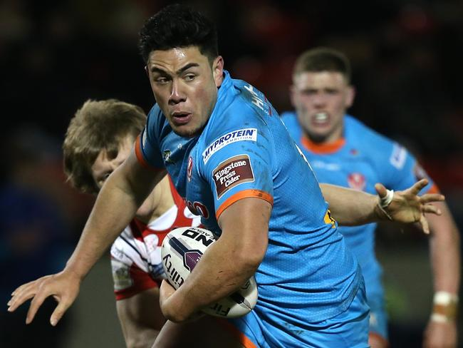 Andre Savelio of St Helens breaks through a tackle.