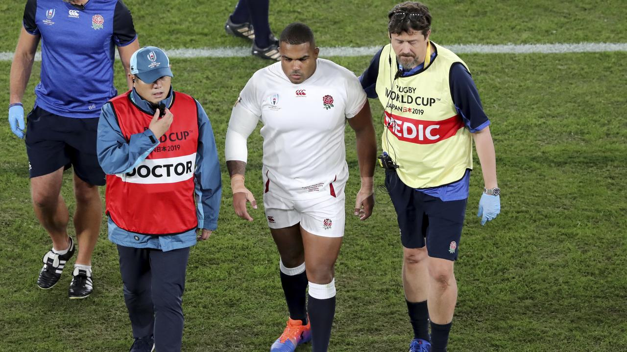 England's Kyle Sinckler leaves the field after getting injured in a collision during the Rugby World Cup final.