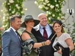 Punters get out their selfie sticks as they arrive at the 2016 Melbourne Cup day of racing at Flemington Racecourse. Picture: Jason Edwards