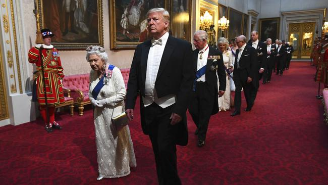 Queen Elizabeth II and U.S. President Donald Trum arriving for the State Banquet at Buckingham Palace in London earlier this month. Picture: Victoria Jones/AP
