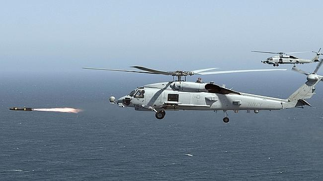 A US Navy MH-60R Seahawk fires a Hellfire missile. Picture: AFP