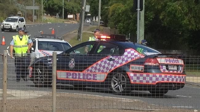 Queensland Police closed Chambers Flat Road after fearing the pot was an explosive device. Picture: Dave Hele