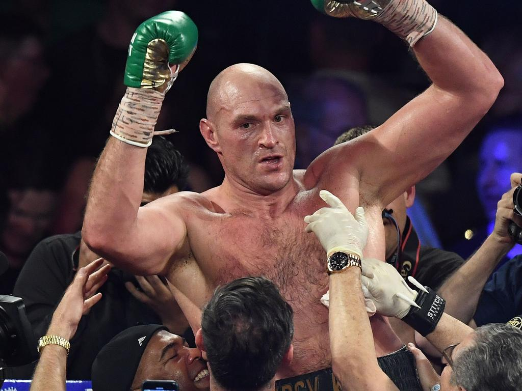 British boxer Tyson Fury celebrates after defeating US boxer Deontay Wilder in the seventh round during their World Boxing Council (WBC) Heavyweight Championship Title boxing match at the MGM Grand Garden Arena in Las Vegas on February 22, 2020. (Photo by Mark RALSTON / AFP)