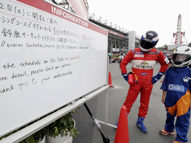 This information board shows the cancellation of Saturday's schedule for Japanese F1 Grand Prix. Picture: AP