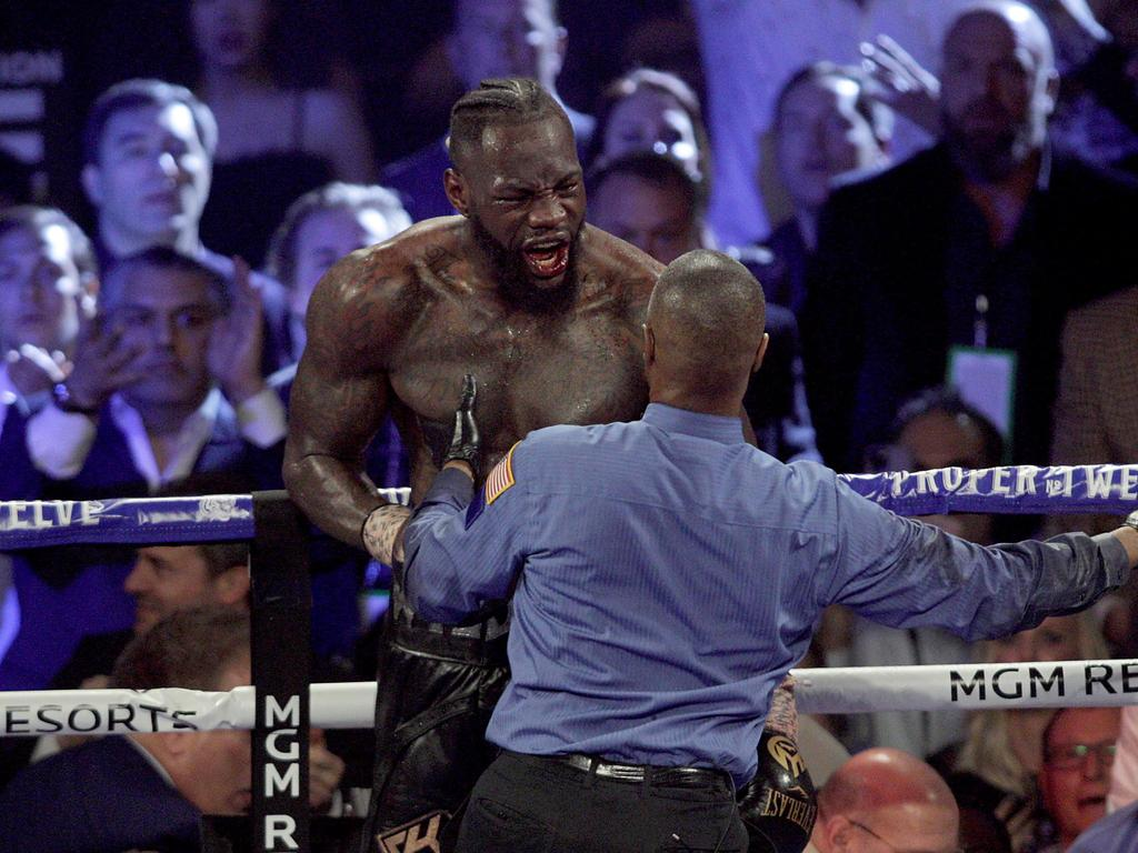 Deontay Wilder reacts during his Heavyweight Championship boxing match against Tyson Fury.