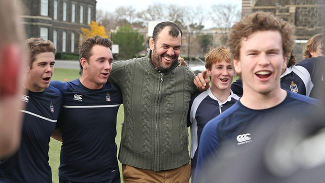 Michael Cheika sings with students at Melbourne Grammar School.