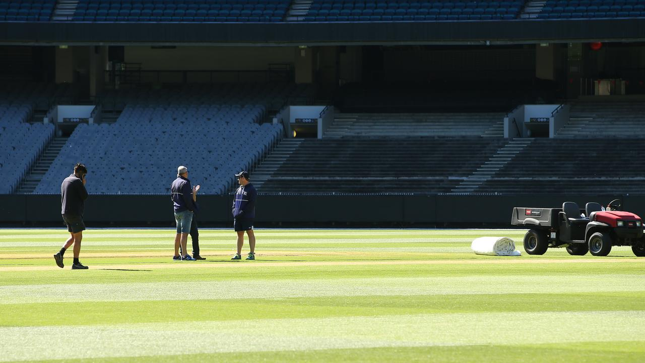The pitch is inspected after the Shield match's abandonment.