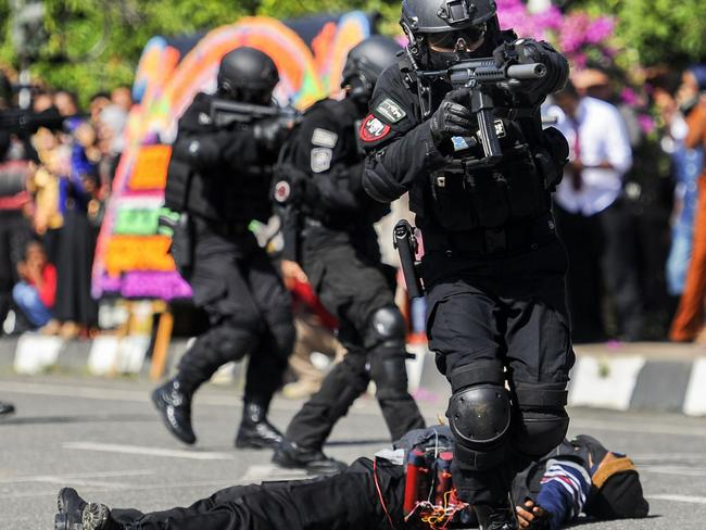 Police from the anti-terror squad participate in an anti-terror performance during a ceremony to commemorate the 71st anniversary of the Indonesian police corps in Banda Aceh earlier this week. Picture: AFP