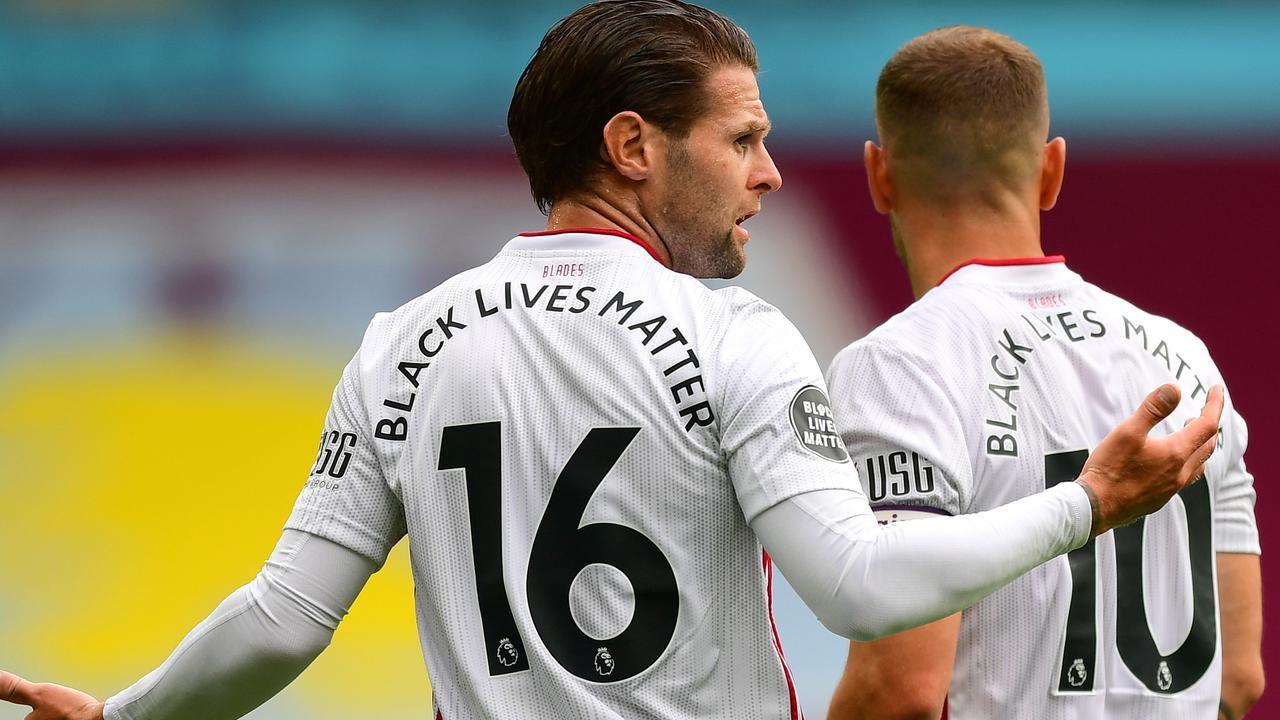 Black Lives Matter writing is seen on the back of Ollie Norwood and Billy Sharp of Sheffield United shirts. (Photo by Shaun Botterill/Getty Images)