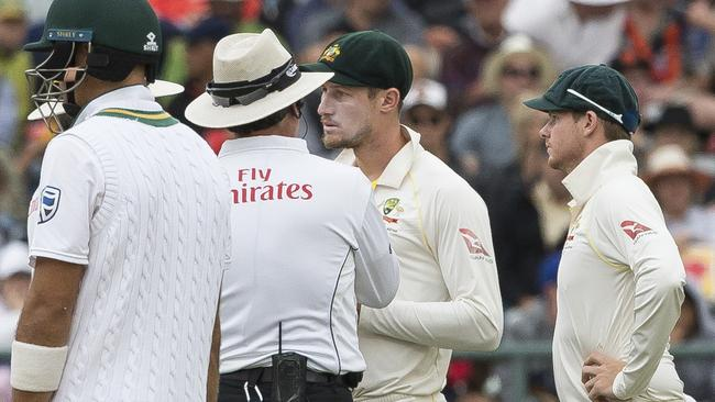 Cameron Bancroft is spoken to by umpires.