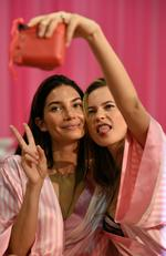 Lily Aldridge and Behati Prinsloo are seen backstage before the 2015 Victoria's Secret Fashion Show at Lexington Avenue Armory on November 10, 2015 in New York City. Picture: Getty