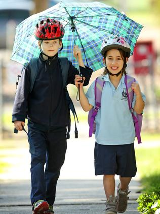 Chirnside Park Primary School student Jaylen and Gabby hide from magpies. Picture: Mark Stewart