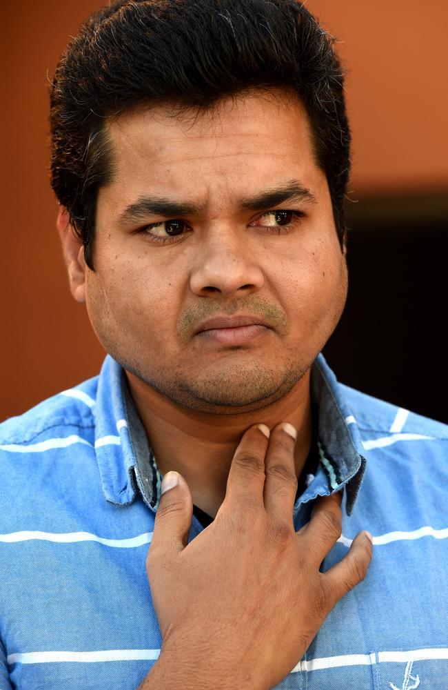Prabhath Ponnamaneni shows where he had a knife held to his throat. Picture: Nicole Garmston