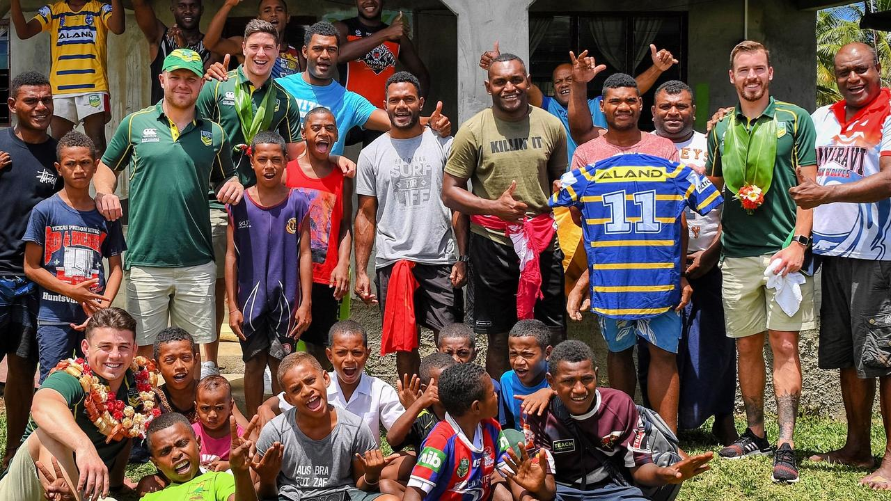 Eels players visit the village of teammate Maika Sivo while in Fiji. Picture by the Australian Kangaroos.