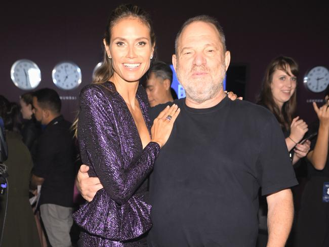 Project Runway host Heidi Klum with Weinstein, whose name has been hastily removed from the show's credits since the scandal broke. Getty