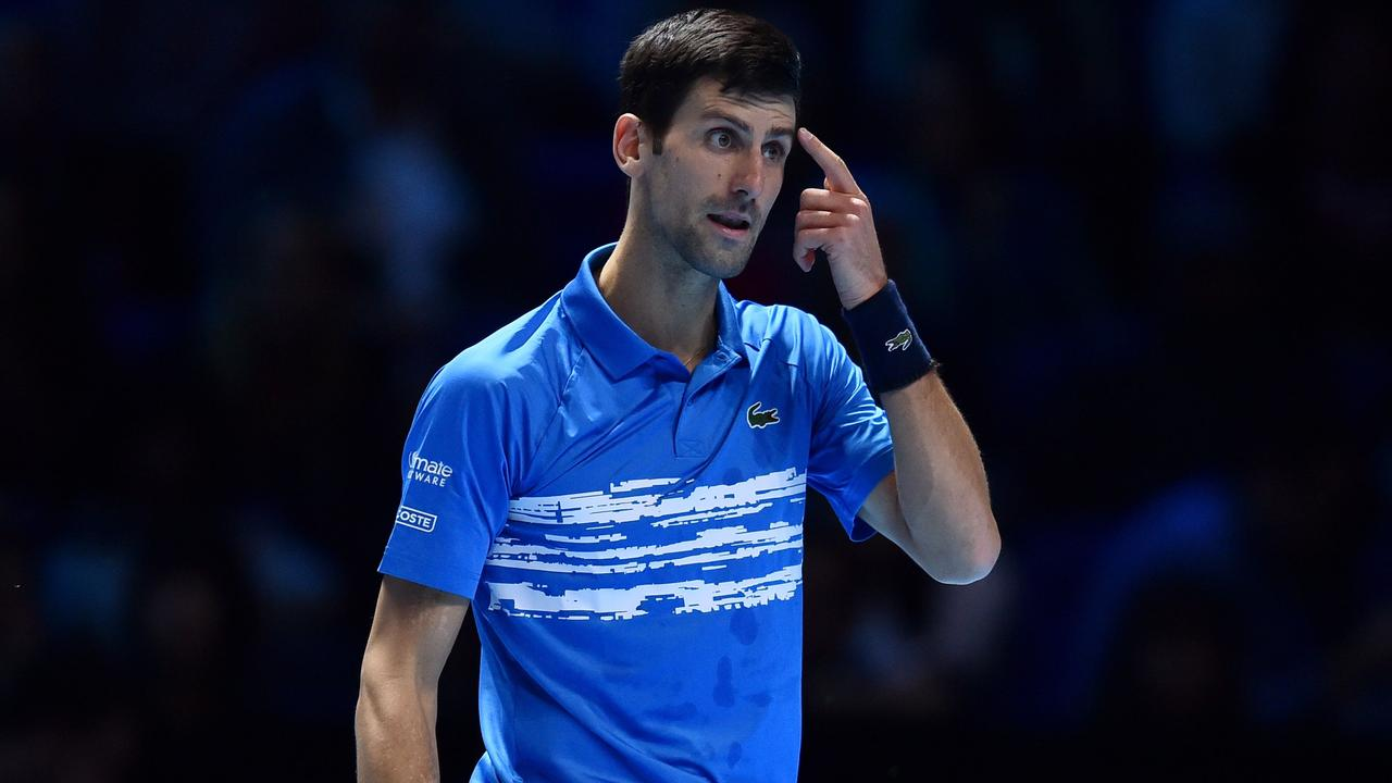 Novak Djokovic during his most recent match against Dominic Thiem - a loss, on a hard court, at the 2019 ATP Finals in London. (Photo by Glyn KIRK / AFP)