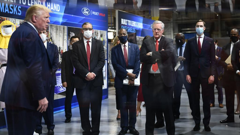 Mr Trump and Mr Meadows appeared without masks. The Ford executives did wear them, plus Mr Trump's son-in-law Jared Kushner. Picture: Brendan Smialowski/AFP