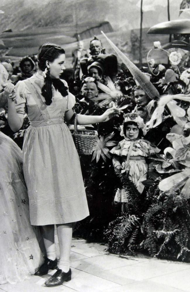 Judy Garland, then aged 16, greets the munchkins in The Wizard of Oz. Picture: Supplied