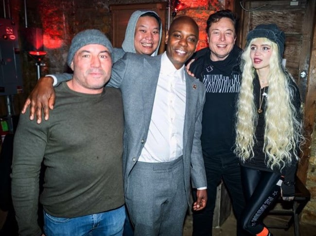 Dave Chappelle was spotted with Joe Rogan, Elon Musk and musician Grimes two days before his diagnosis.