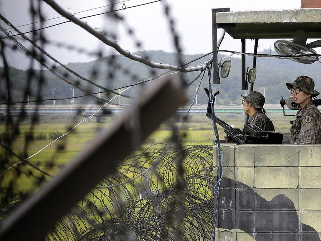 Arrest ... South Korean army soldiers stand guard at a military check point at the Imjingak Pavilion near the border village of Panmunjom. Picture: AP