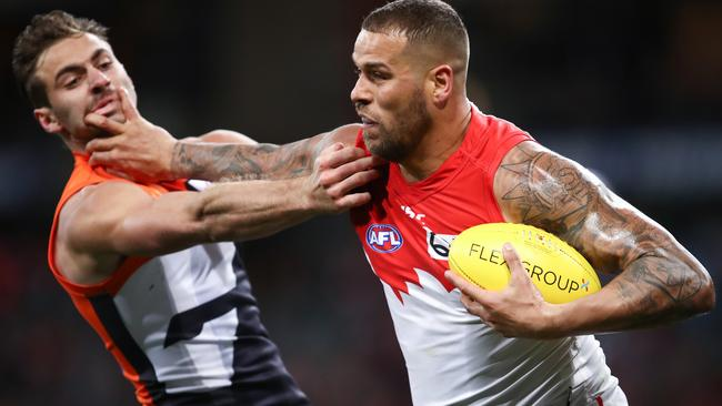 Lance Franklin fends off Giant Stephen Coniglio last month. Picture: AAP Image/Brendon Thorne