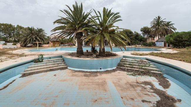 This swimming pool used to be packed with tourists during the summer. Picture: Bob Thissen/Caters News Agency