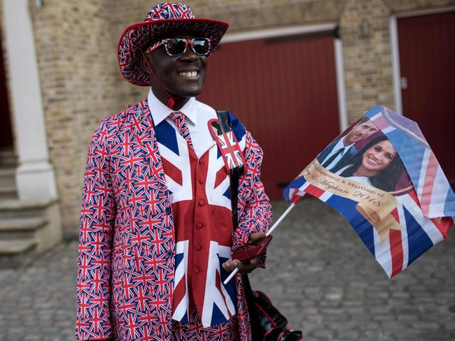 Royal fan Joseph Afrane waits near the proposed route of the carriage procession two days before the Royal wedding. Picture: AFP