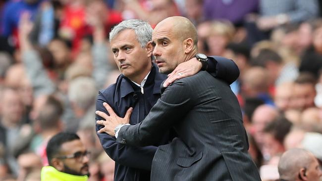 Manchester United manager Jose Mourinho (L) and Manchester City manager Pep Guardiola.