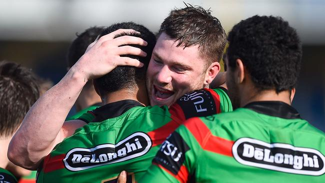Chris McQueen celebrates after scoring a try.