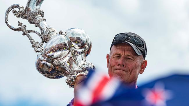 Emirates Team New Zealand CEO Grant Dalton hoists the trophy.