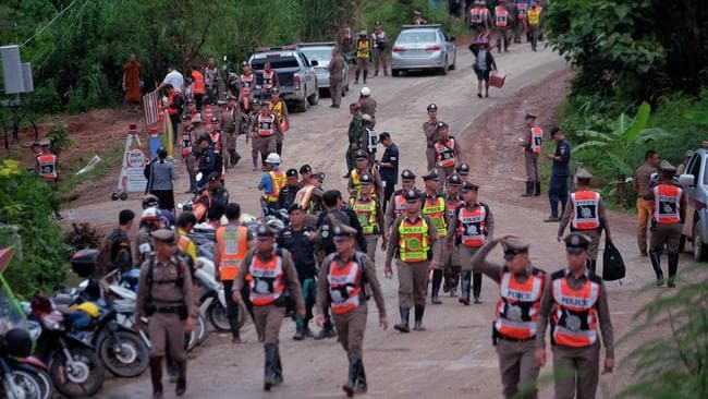 Policeman line up on the main road leading to Tham Luang Nang Non cave where the boys and their coach are trapped. Picture: Linh Pham/Getty Images.