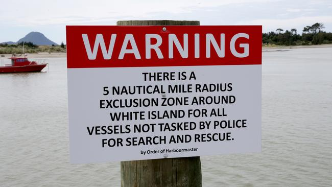 A sign warning of the White Island exclusion zone. Picture: AAP Image/David Rowland.