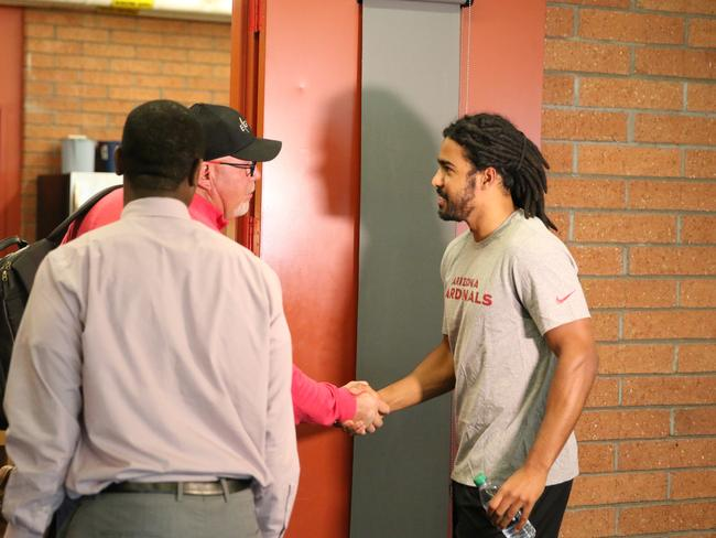 Joel Wilkinson after signing with the Arizona Cardinals.