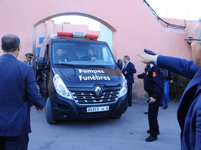 Moroccan police officers driving a truck carrying the bodies of the two murdered Scandinavian hikers as they are being transported from a morgue in the capital Marrakesh to the airport. Picture: AFP