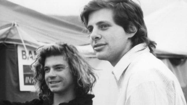 Hutchence with his film director mate Richard Lowenstein backstage at a gig. Picture: Supplied.