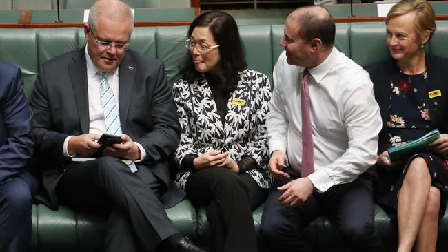 Gladys Lui sat with Prime Minister Scott Morrison and the Treasurer Josh Frydenberg during the division in the House of Representatives in Parliament House Canberra. Picture: Gary Ramage