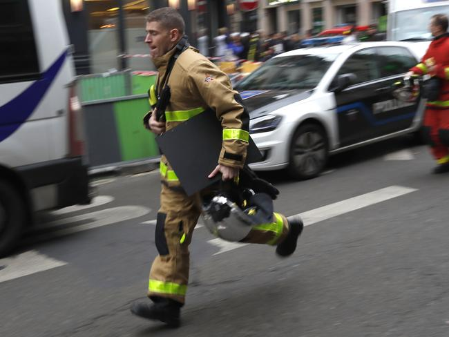 A firefighter rushes to the scene of a gas leak explosion in Paris, France. Picture: AP