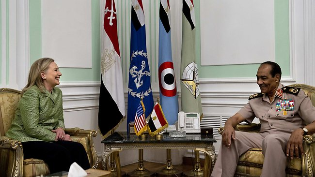 US Secretary of State Hillary Clinton meets with Egypt's head of the military council Field Marshal Hussein Tantawi at the Ministry of Defence in Cairo. Clinton was holding talks with Egypt's top military leaders, just hours after calling for them to help smooth the country's full transition to democracy. Pic: AFP