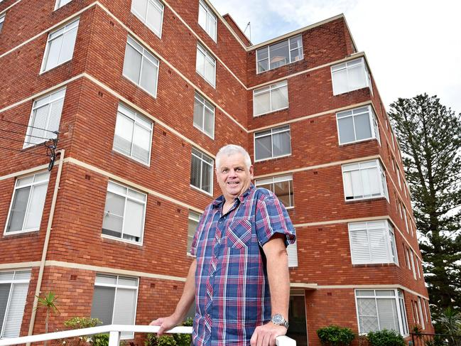 Chris Lobb outside his family's apartment at Manly.