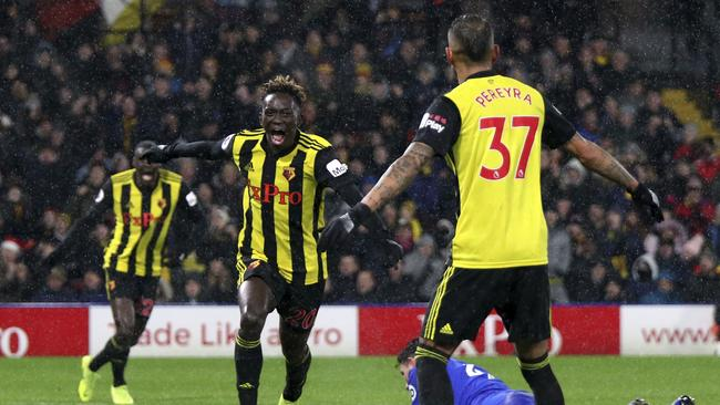 Watford's Domingos Quina, center, celebrates scoring his side's third goal