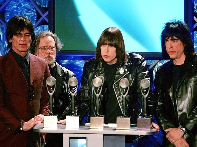RIP ... Dee Dee Ramone with Tommy, Johnny, and Marky - members of punk music rock band The Ramones - being inducted into the Rock and Roll Hall of Fame in 2002.