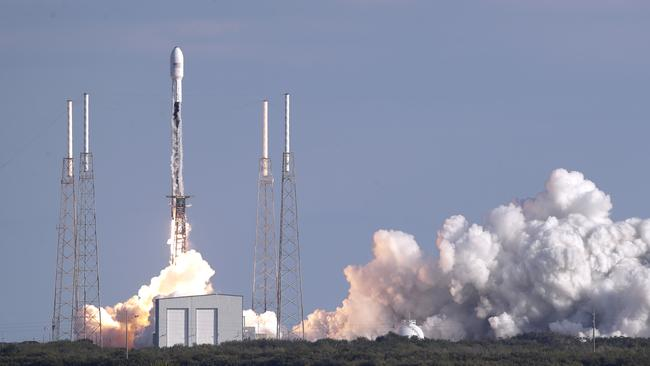 A SpaceX rocket carrying satellites into space last week. Picture: AP Photo/John Raoux