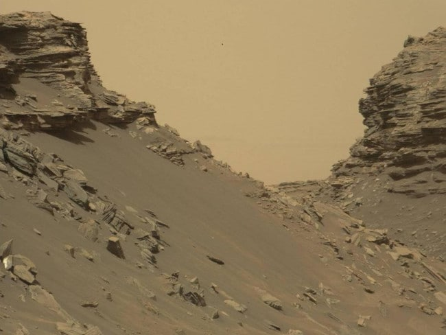 Nasa's Curiosity rover took this image, which shows sloping buttes and rocky, layered outcrops on Mount Sharp. The buttes are eroded remnants of ancient sandstone. Picture: NASA