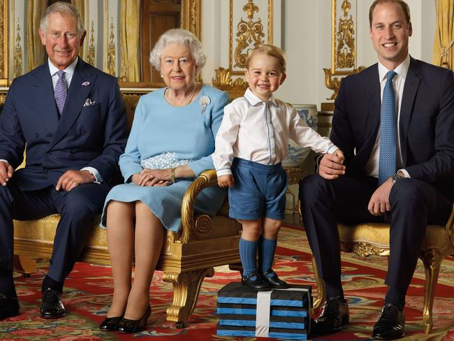 His Royal Cuteness Prince George (second right) with Prince Charles, the Queen and his father Prince William on the 90th birthday stamp.