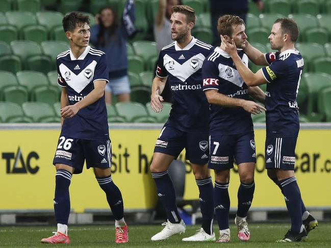 Callum McManaman (second from right) celebrates with his Victory teammates after scoring against the Mariners. Picture: Daniel Pockett/Getty Images